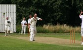 The delight shows on the face of Ashley Legge of Pymoor Cricket Club as the umpire gives the Wilburton CC batsman 'Out'.