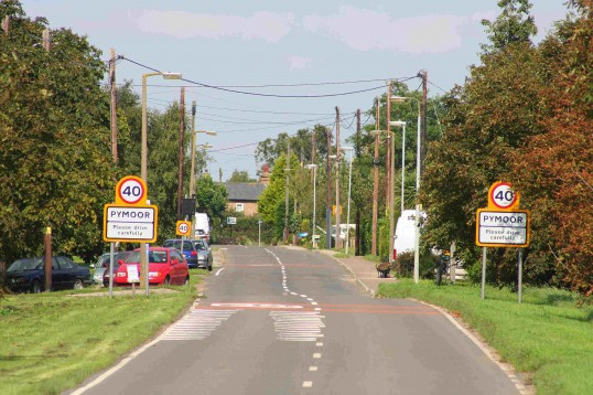 Main Street, Pymoor, looking towards the village sign at the crossroads (Pymoor Hill)