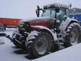 A snowbound tractor in Pymoor 2008.