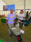 Bill Dennis and Inger van Ogtrop sell raffle tickets for the 'Wheelbarrow full of Booze' at the Pymoor Show 2008.
