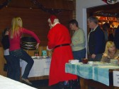 Santa wins a raffle prize at the Pymoor Social Club Christmas Bazaar 2008.