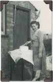 Margaret Fletcher of Pymoor cuts her 21st Birthday cake, circa 1956.