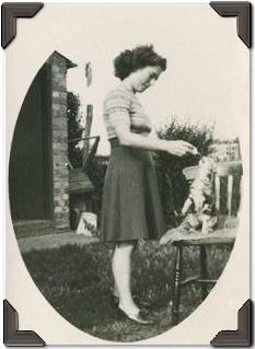 Margaret Fletcher of Pymoor in her garden with her cat.