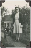 Margaret Fletcher of Pymoor in her garden with her cat.