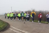 Competitors in the Annual New Year's Eve 10K Fun Run near the junction at Main Drove, Pymoor.