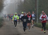 Competitors in the Annual New Year's Eve 10K Fun Run 2009 make their way down Pymoor Lane, Pymoor.