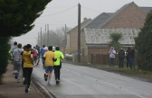 Competitors in the Annual New Year's Eve Fun Run 2009 turn into Main Street Pymoor on their way back to Little Downham.