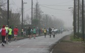 Competitors in the Annual New Year's Eve 10K Fun Run 2008 make their way down Main Street, Pymoor, on their way back to Little Downham.