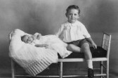 Alan Golding aged 4 years with his brother Norman Golding aged 9 weeks. Both of Pymoor.