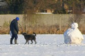 Steve Knowles and his dog 'Ruby' enjoy the snow on the Pymoor Sports Club field, Pymoor Lane, Pymoor.