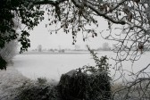 A view from Pymoor Lane, Pymoor, south across the fields to Main St. after the heaviest fall of snow seen in the village for many years.