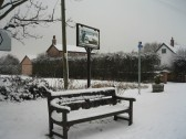 Bench and Pymor village sign after the heaviest fall of snow seen in Pymoor for 18 years 2009.