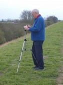Roger Davis, of the Pymoor Community Archive Group, tries out the Group's new camcorder on the Hundred Foot Bank, Pymoor.