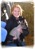 Pat Golding holding a lamb in Pymoor 2009.