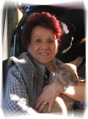 Christine Saberton with a lamb in Pymoor 23/03/2009.