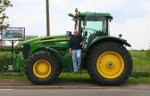 A John Deere 7920 tractor arrives at the crossroads in Pymoor for the Archive Group's Calendar photo shoot 2009.