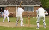 The stubborn resistance of the Wilburton batsman is brought to an end by Jamie Russell of Pymoor CC 2009.