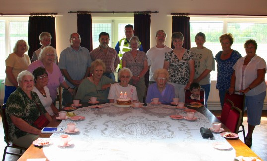 Joan Saberton celebrates her 93rd Birthday (16th July) with a group of friends at the monthly Coffee Afternoon in the Cricket Club in Pymoor 2009.