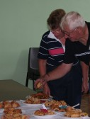 Joan & Alan Butcher of Pymoor check out the results of the Good Companions Men's Rock Cake competition 2009.