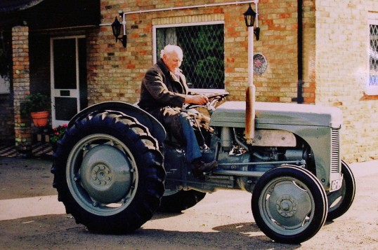 David Savage on a Massey Ferguson tractor at Jubilee Cottage, Pymoor Lane, Pymoor, 2007.