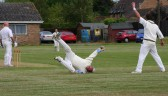 Pymoor wicketkeeper Mark Neighbour dives to make an important catch in Pymoor CC's victory against Wimblington CC. 2009