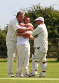 Unbridled joy as Paul Ruskin and Mark Neighbour celebrate another wicket taken by Pymoor CC captain Steve Saberton against Wimblington CC 2009.