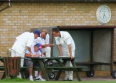 Team members help Pymoor CC team captain Steve Saberton work out the batting order for their forthcoming innings at Wimblington CC. 2009