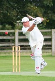 Pymoor CC opening batsman Jack Hargraves drives the ball in the match against Wimblington CC.