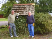 Alan Butcher and Roger Davis prepare to remove 8 years of ivy growth from the Bell Shelter at the Pymoor Methodist Chapel, Pymoor 2009.