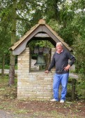 Alan Butcher stands in front of the newly cleaned Bell Shelter he built when he was a 'young' man, outside the Methodist Chapel in Pymoor, 2009