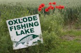Oxlode Fishing Lake sign at the end of School Lane, Pymoor.