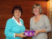 Pymoor Cricket & Social Club Treasure Hunt organiser Christine Saberton presents '2nd Prize' to Liz Finch.