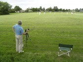 Roger Davis, of the Pymoor Archive & Camera Club, photographing a Pymoor CC match on the Sports Club field in Pymoor Lane, Pymoor 2007.