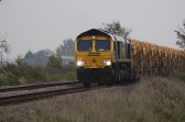 A goods train approaches the crossing near Main drove, Little Downham / Pymoor, 2009.