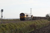 A goods train from Ely approaches the crossing near Main Drove, Little Downham / Pymoor, 2009.