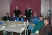 The Pymoor Archive & Camera Group, with their spouses, enjoy coffee &  'nibbles' at their meeting at the Methodist Chapel in Pymoor 2009.