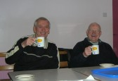 Roger Davis & Cyril Heaps enjoy a cup of coffee at the Pymoor Camera & Archive Group's last meeting of the year 2009.