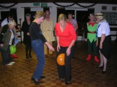 Passing the balloon by only using your knees at the Line Dancing Group's Christmas Party celebrations at the Pymoor Social Club.