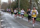 Competitors in the annual Ely 10k Fun Run 2009 make their way along Pymoor Lane, Pymoor.