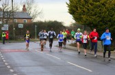 Competitors in the annual Ely 10k Fun Run 2009 turn into Main Street, Pymoor.