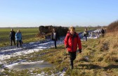 Walkers make their way along a muddy Frith Head Drove on the Pymoor & Oxlode Walk 2010.
