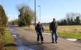 Christine Saberton & Bruce Smith make their way along Pymoor Lane, during the Pymoor & Oxlode Walk 2010. Almost home!