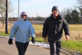 Melanie Grace-Boughton & Bill Dennis make their way along Pymoor Lane, during the Pymoor & Oxlode Walk 2010.