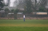 Pymoor FC Manager Tony Ure  inspects the pitch before the Clubs match the following day. Over the winter the pitch has been very wet.