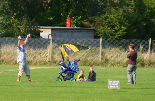 Mark & Becky Taylor, with their family, enjoy the fun of kite flying on the Pymoor Cricket Club field in Pymoor Lane, Pymoor.