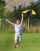 Mark Taylor realises that his kite has the aerodynamics of a broken brick as he stuggles to get it airborne on the Pymoor Cricket Club field 2008.