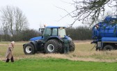 Joan Saberton comes to see what is going on with the stuck truck in a field off Pymoor Lane, Pymoor.