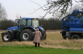 91 year old Joan Saberton asks James Golding if he needs any help in moving the stuck truck in a field off Pymoor Lane, Pymoor.