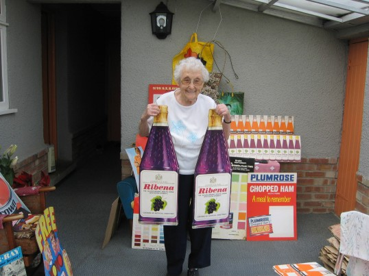 Joan Saberton, who used to own Saberton Stores in Main Street, Pymoor, with some of the advertising displays from the shop.