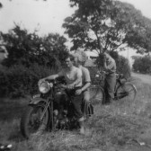 Bill Cornwall of Pymoor on his BSA 500 Motorbike. Ivan Martin is riding pillion. They are on the corner of Pymoor Lane.